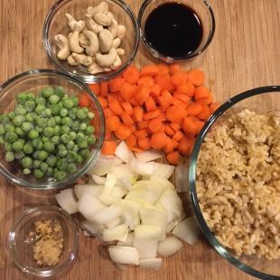 rice, peas, cashews, carrots, onions, ginger, garlic, soy sauce, egg